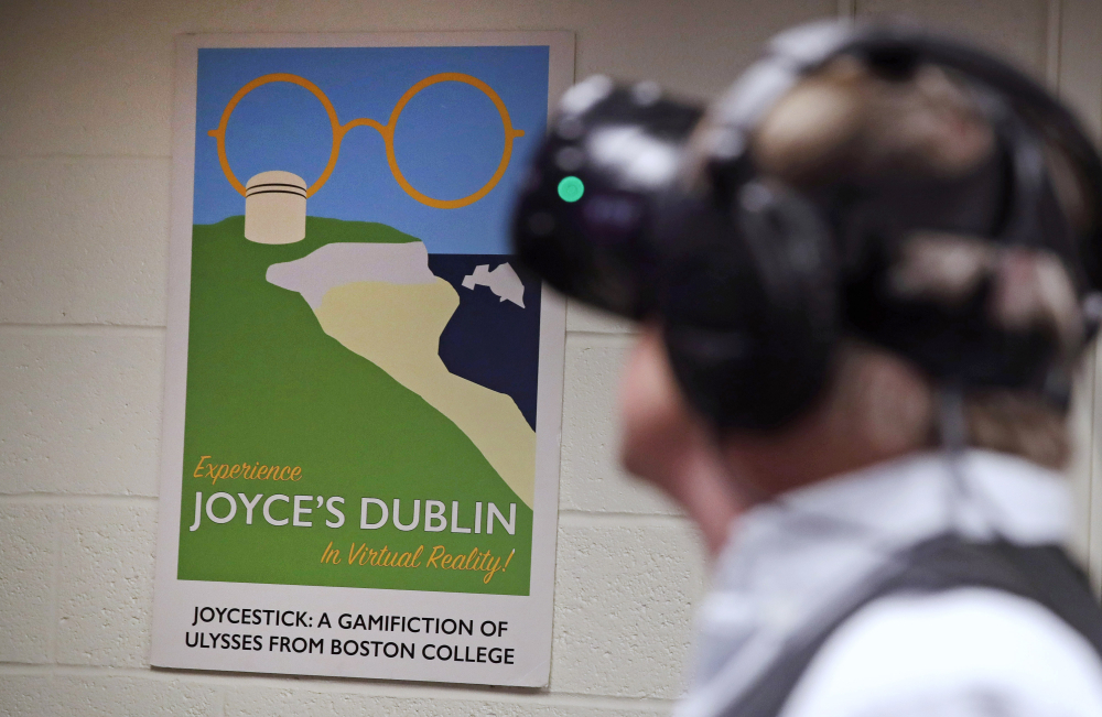 Joseph Nugent, a professor of English at Boston College, wears virtual reality goggles at the school's virtual reality lab in Boston. College students in Boston are developing a virtual reality game based on James Joyce's ponderous tome