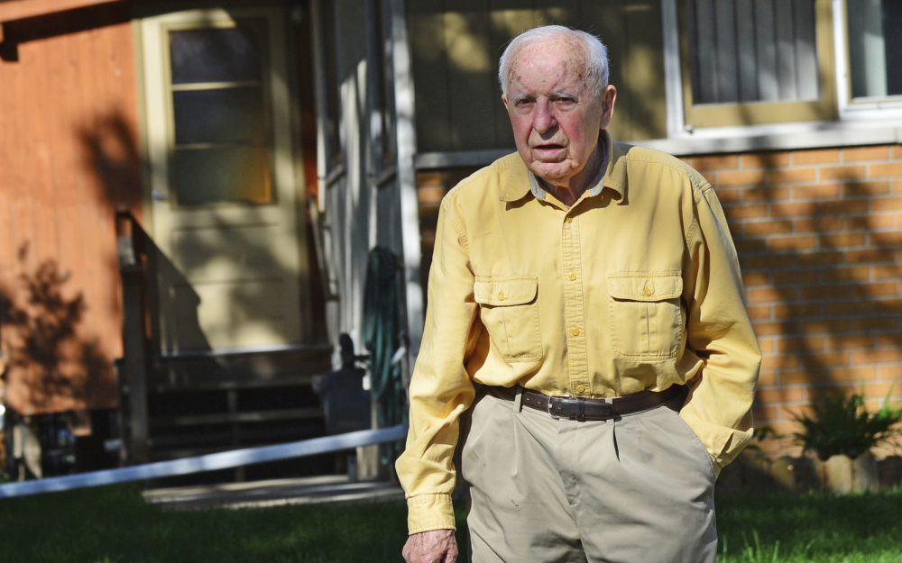 Michael Karkoc works in his yard in Minneapolis. Poland will seek the arrest and extradition of Karkoc, accused of being a commander in an SS-led unit that burned Polish villages.