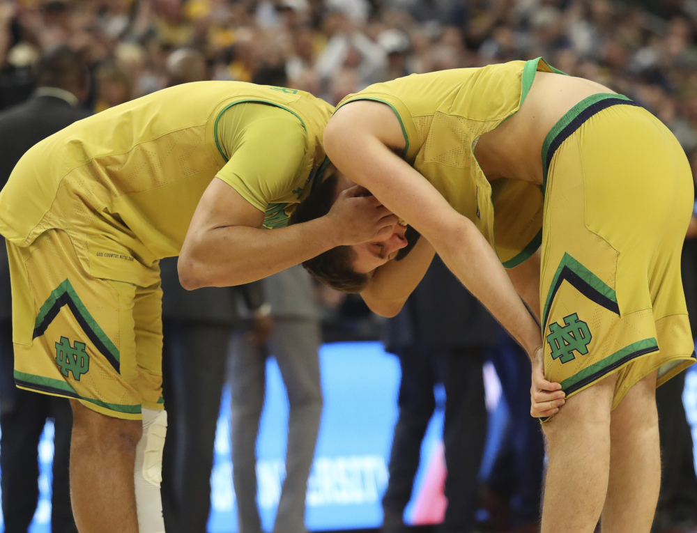 Austin Torres, left, and Matt Ryan of Notre Dame react Saturday after the 83-71 loss to West Virginia at Buffalo, N.Y., in a second-round game of the NCAA tournament. West Virginia will play Gonzaga on Thursday.