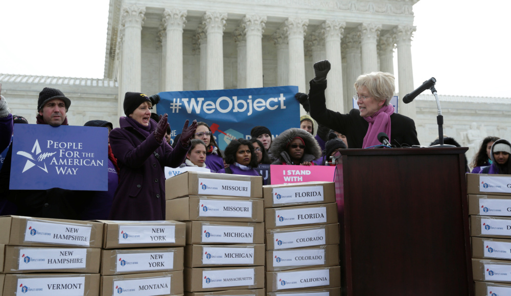 Massachusetts Sen. Elizabeth Warren speaks in front of the U.S. Supreme Court on Wednesday to kick off the delivery of petitions calling on senators to oppose Supreme Court nominee Judge Neil Gorsuch.