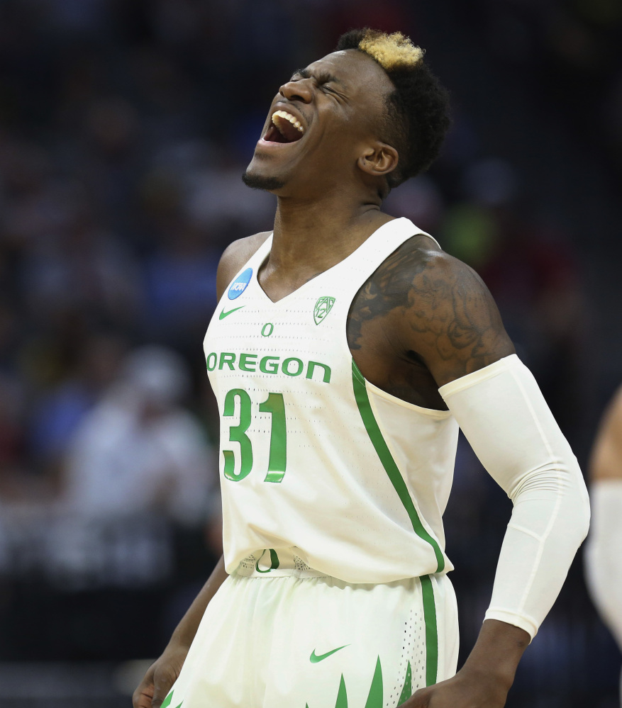 Oregon's Dylan Ennis celebrates during his team's 75-72 comeback victory against Rhode Island in Sacramento, Calif.