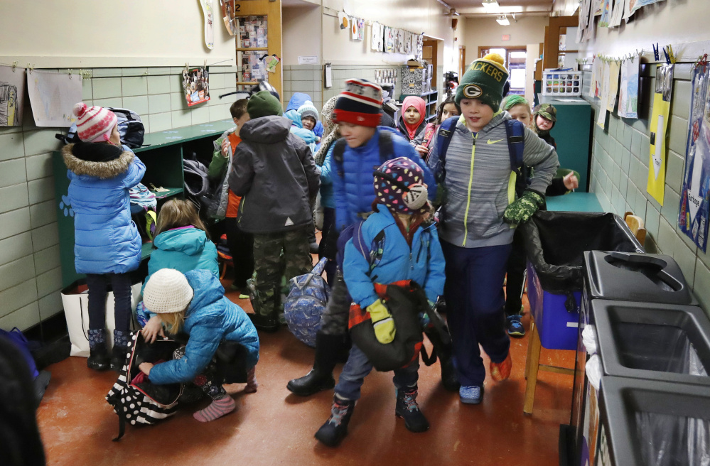 Students arrive and unpack for the start of the school day Friday at Longfellow Elementary School in Portland, one of four being considered for renovations. The largest school bond under discussion, for $64 million, mostly addresses health, safety and learning issues.