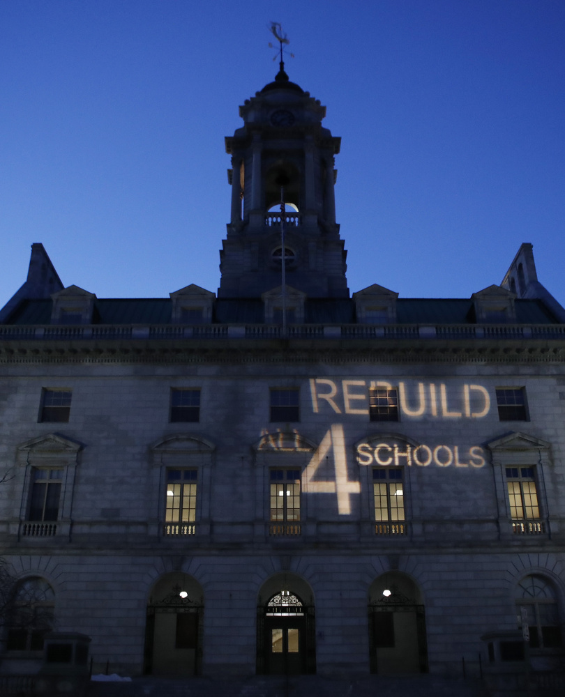 A light display intended to encourage city councilors to approve placing a $64 million school bond on the ballot is projected Monday on City Hall.
