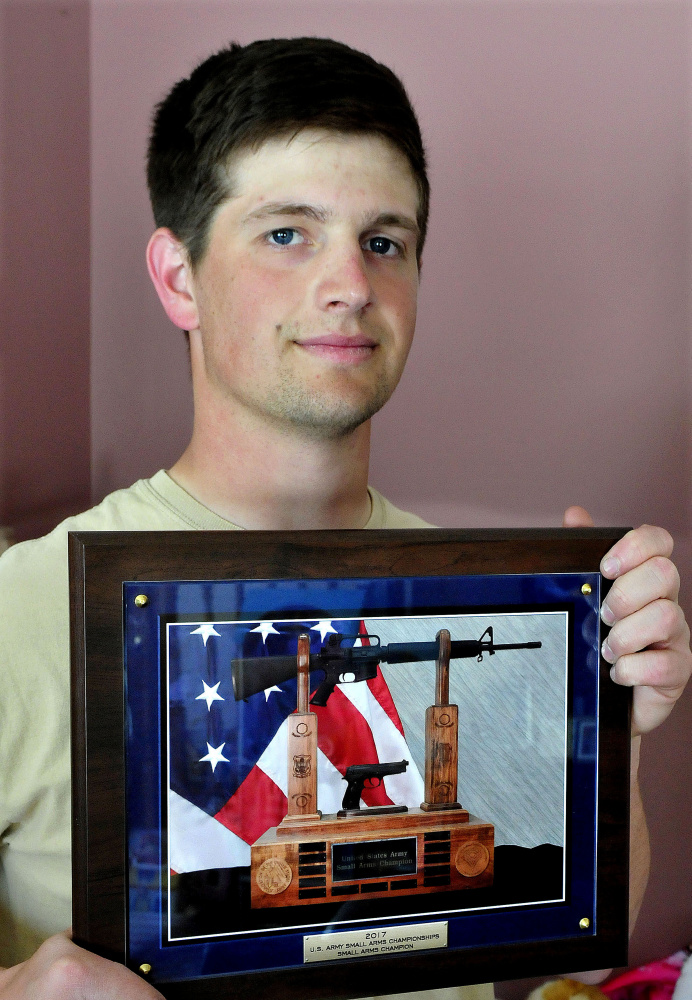 National Guardsman Max Nickerson holds an award for overall profiency with both a rifle and a handgun, presented to him at the U.S. Army Small Arms Championships.