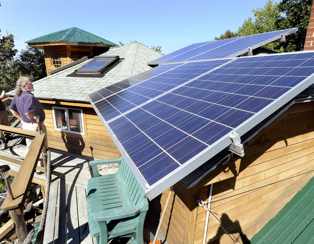 Michael Mayhew's green home in Boothbay Harbor features many solar panels. A bill that aimed to prevent changes to the credits for solar panel owners passed the Maine House 105-40 and cleared the Senate 29-6 – both apparently veto-proof majorities.