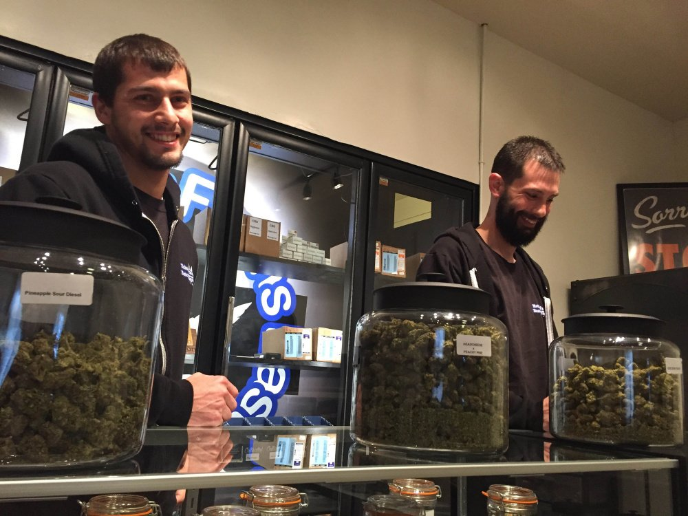 Steve Meland, left, and Jeremy Breton are co-owners of Hotbox Farms, one of two marijuana dispensaries in Huntington, Oregon, a city that has been dying but has hopes new sales tax revenue will help revive the flagging economy.