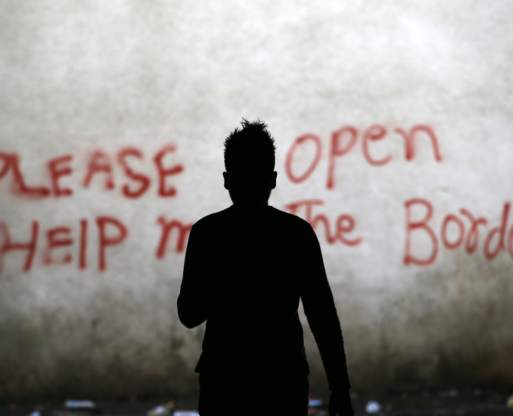 A migrant walks through an abandoned warehouse in Belgrade, Serbia, serving as a makeshift shelter for hundreds trying to reach Western Europe on Tuesday. Thousands of migrants have been stranded in Serbia.