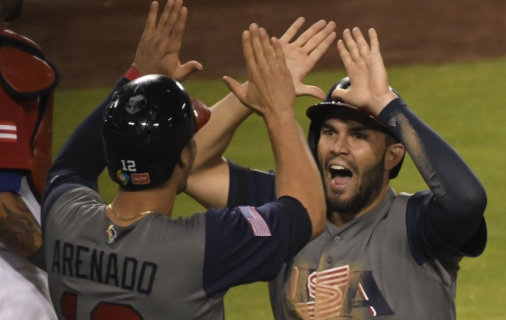 Eric Hosmer, left, and Nolan Arenado celebrate during the United States' 8-0 win over Puerto Rico in the 2017 World Baseball Classic on Wednesday.