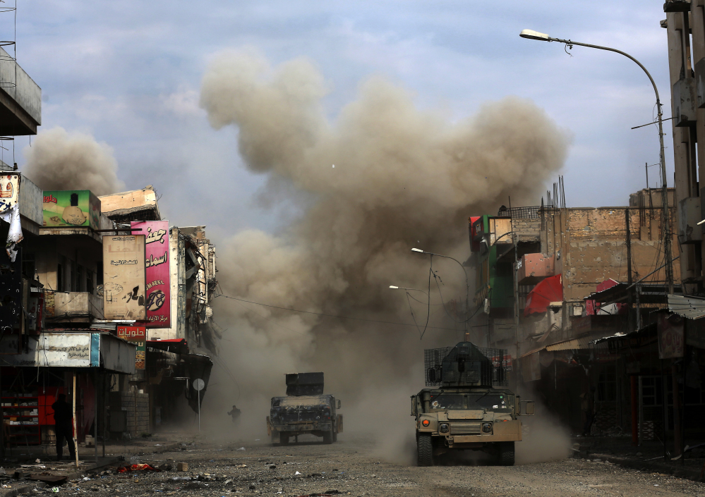 Three roadside bombs laid by Islamic State militants explode in Mosul, Iraq, on March 8, killing one of the Iraqi engineers trying to defuse the devices. Groups like the Islamic State didn't exist in 2001, so it's absurd to say that the war authorization passed after the Sept. 11 attacks applies to them.