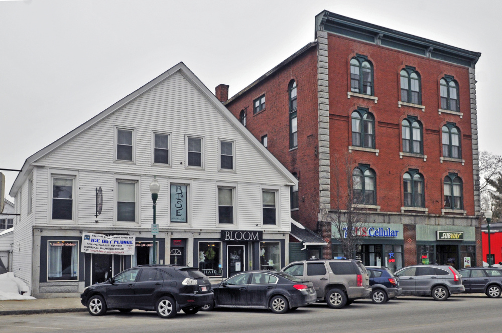 Kim Stoneton proposes to establish a shop to be called 8's Coffee Bar in the left side of the first floor of the wood-frame building, at left, that she owns at 130 Main St. in downtown Winthrop.