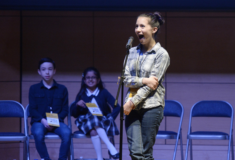 """Naomi Zarin of the Friends School of Portland reacts after winning the Maine State Spelling Bee on Saturday. She correctly spelled the word """"copal"""" in the 42nd round."""