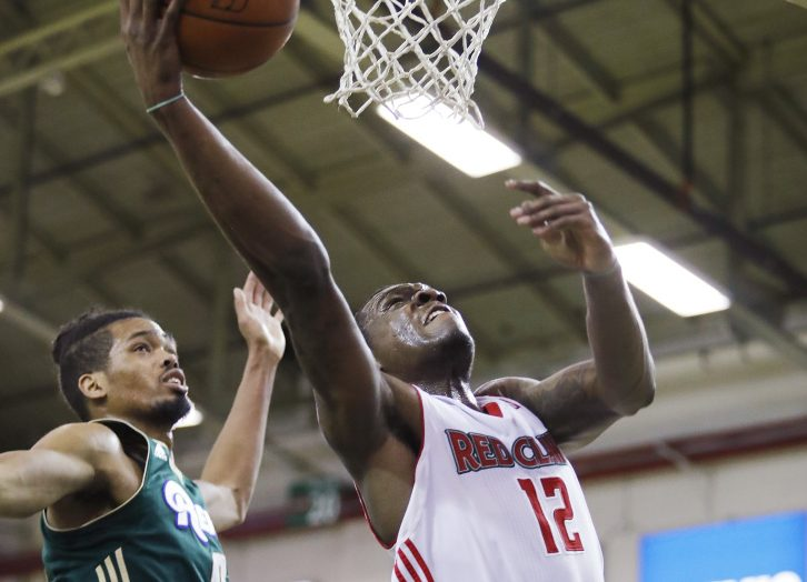 Maine's Jalen Jones goes up for a shot while being guarded by Reno's Will Davis II during the Red Claws' 125-118 loss Sunday. Jones had 25 points in Maine's last home game of the regular season.
