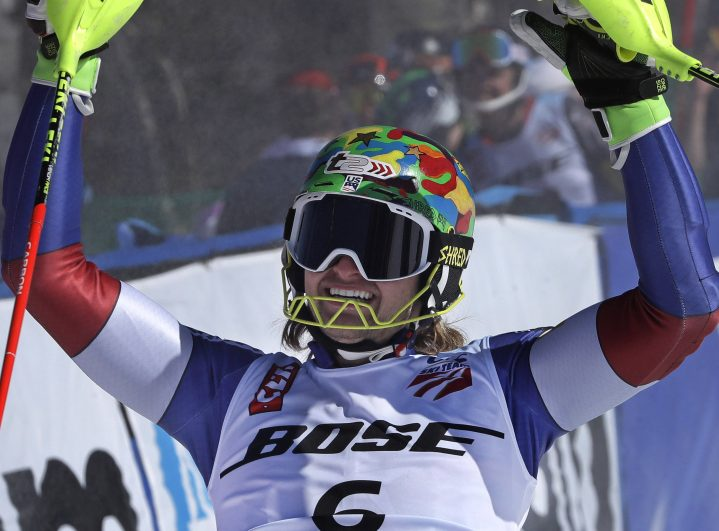 AJ Ginnis pumps his fists after completing his second run to win the men's slalom Sunday at the U.S. Alpine Championships at Sugarloaf.