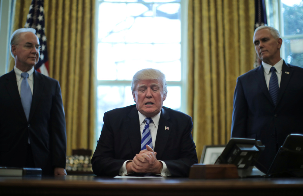 President Trump talks to journalists Friday after the Republican health care bill was withdrawn before a House vote. With him are Health and Human Services Secretary Tom Price, left, and Vice President Mike Pence.