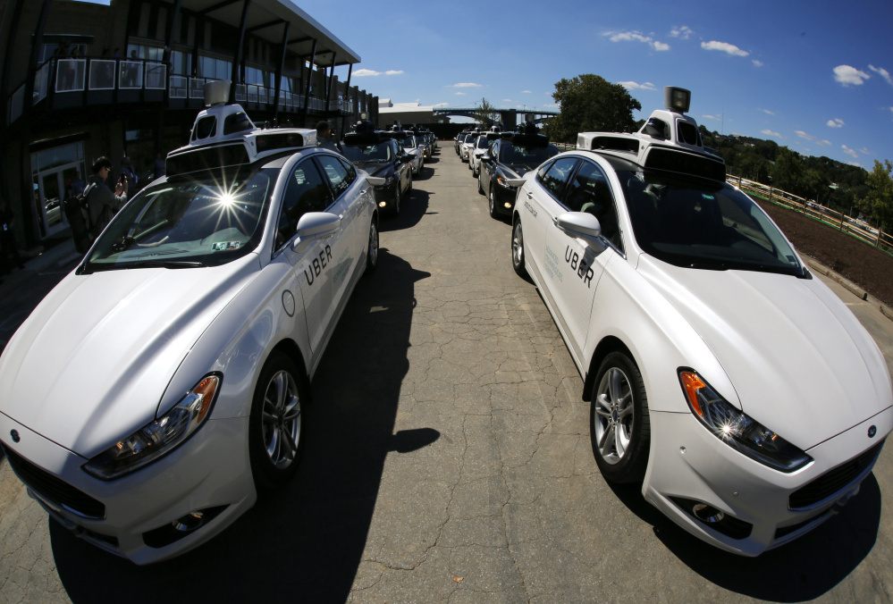A group of self-driving Uber vehicles position themselves to take journalists on rides during a media preview at Uber's Advanced Technologies Center in Pittsburgh.