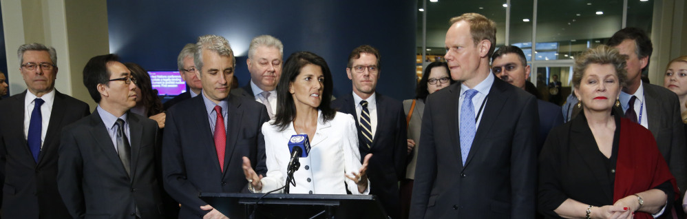 Surrounded by representatives from supporting countries, U.S. Ambassador to the United Nations Nikki Haley, center, speaks to reporters outside the General Assembly at U.N. headquarters Monday.