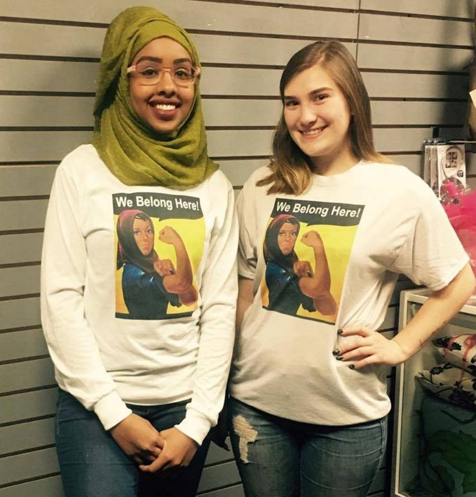 Portland High School senior Zahra Abukar, left, and Windham High School senior Taylor Rickett show off the T-shirts.