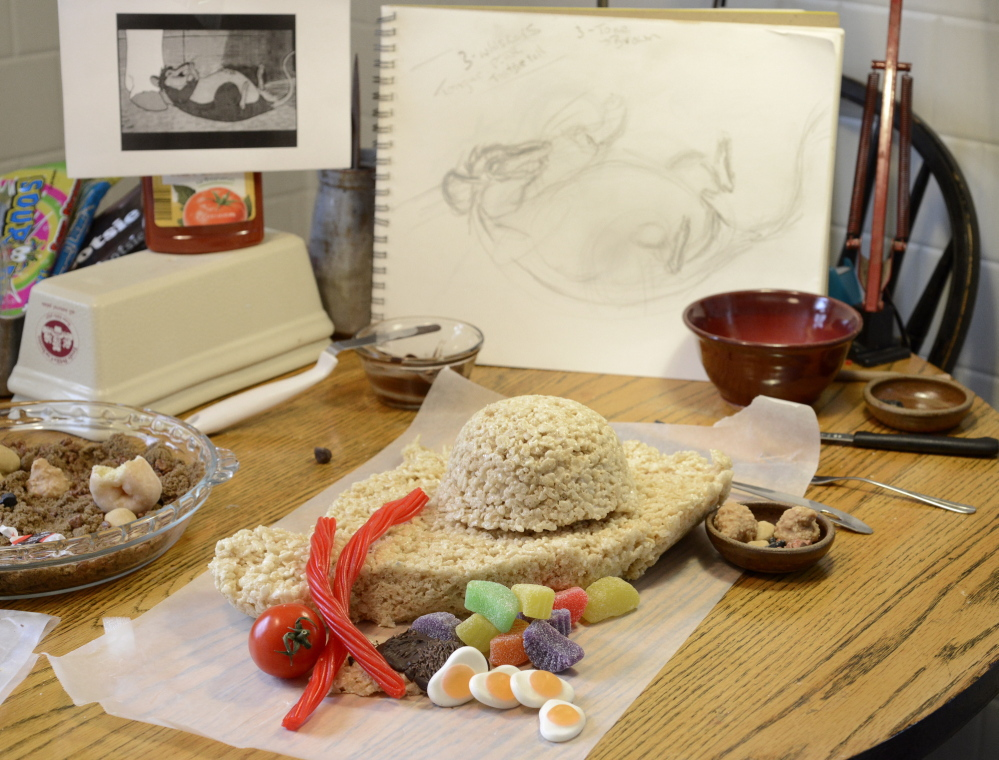 """Deborah Klotz of Portland is taking on """"Charlotte's Web"""" for the Edible Book Festival. Assorted ingredients on her table will make Templeton the Rat."""