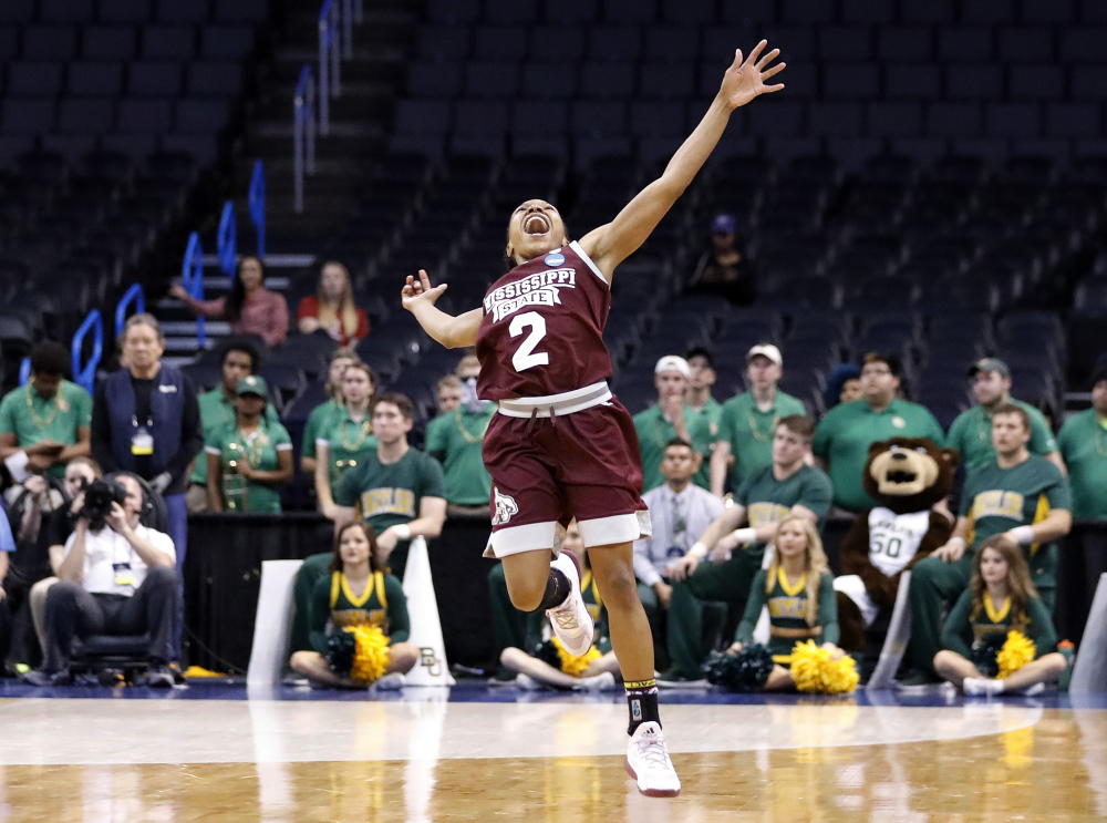 Mississippi State's Morgan William celebrates after the Bulldogs' 94-85 overtime win against Baylor in the regional final on Sunday. Next up: heavily favored Connecticut.