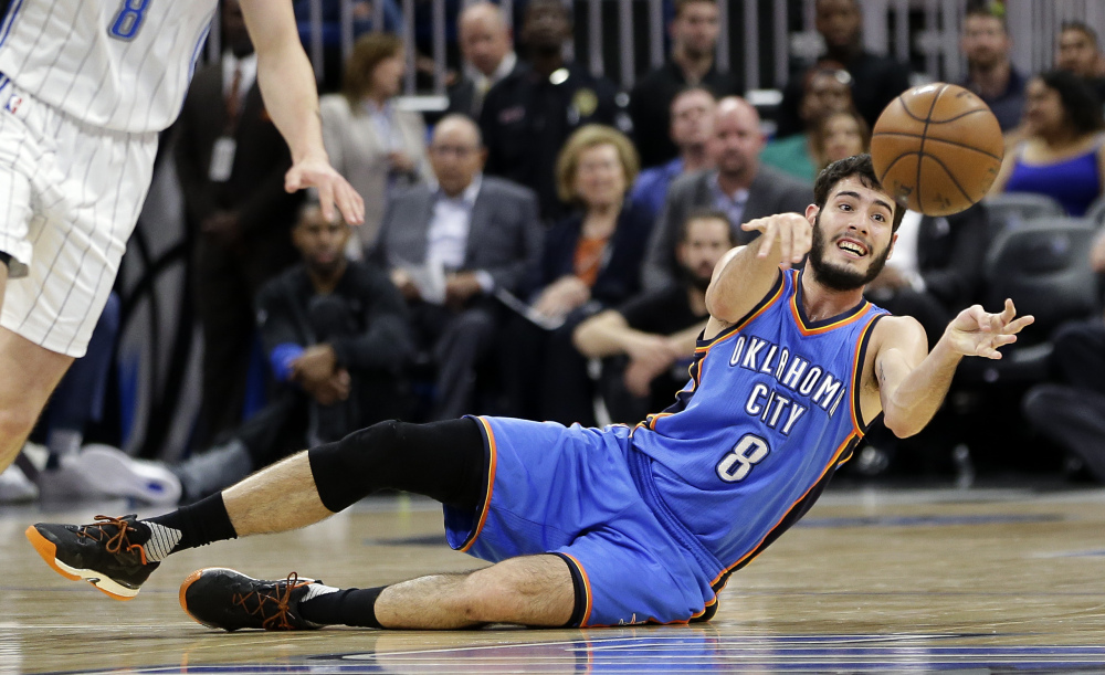 Oklahoma City's Alex Abrines makes a pass after scooping up a loose ball during the first half of the Thunder's game against the Magic on Wednesday night in Orlando, Florida. The Thunder rallied for an OT win.