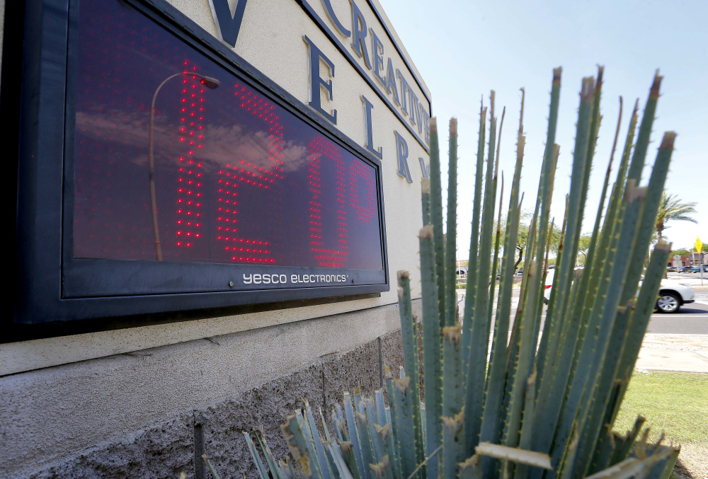 A sign in direct sunlight indicates 120 degrees in Phoenix in 2016. Phoenix is one of many U.S. cities facing what seems to be the inevitable reality of a hotter and drier future. Public health and economic prosperity are both at risk