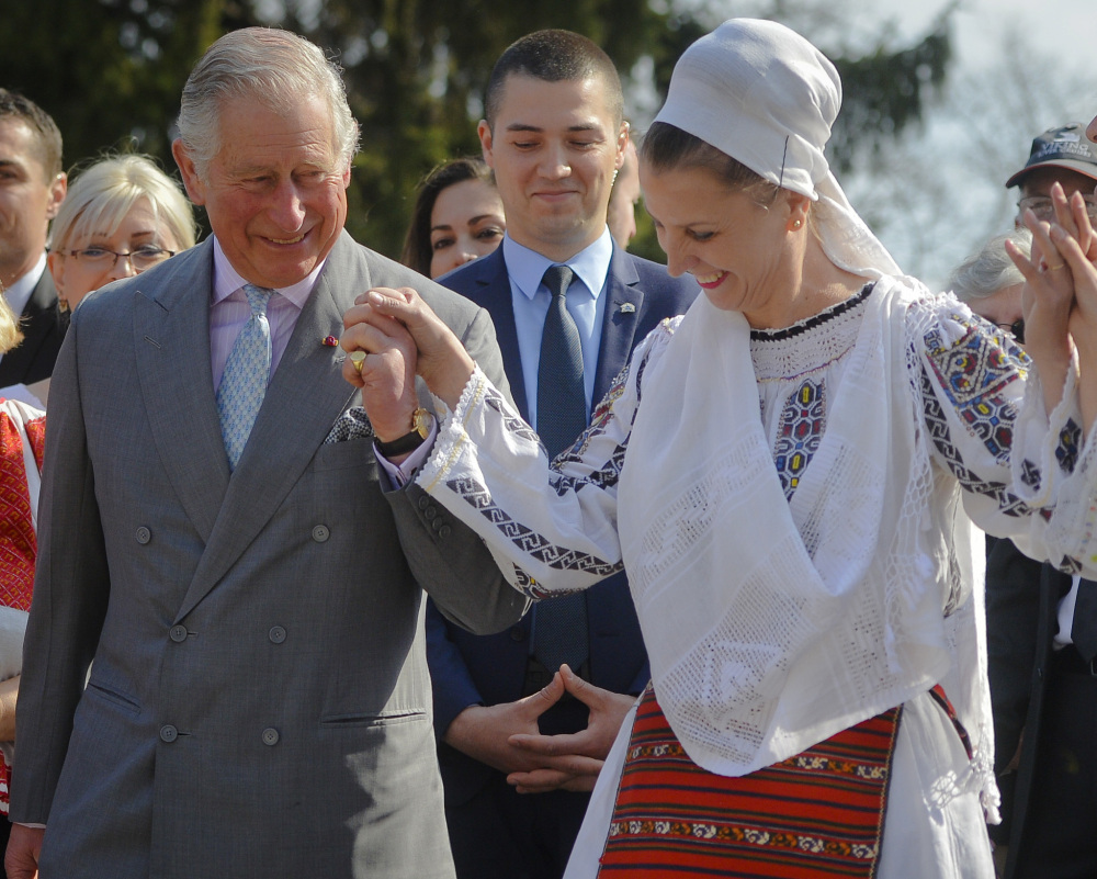 Britain's Prince Charles joins a traditional folk dance Thursday in Bucharest, part of an effort to reassure European Union nations that Britain remains an ally.