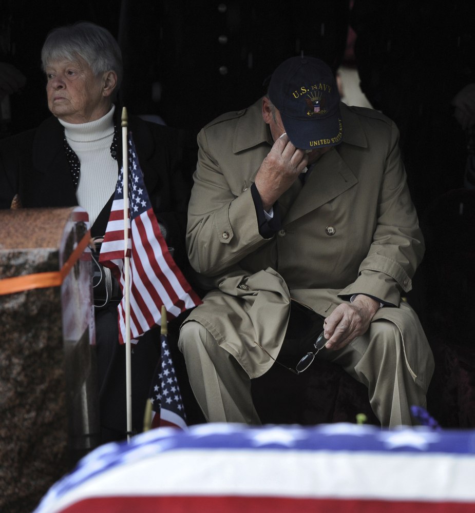 Relative Robert Whelihan wipes away a tear during the graveside service for Army Cpl. Jules Hauterman Jr., who was laid to rest in Holyoke, Mass., on Friday.