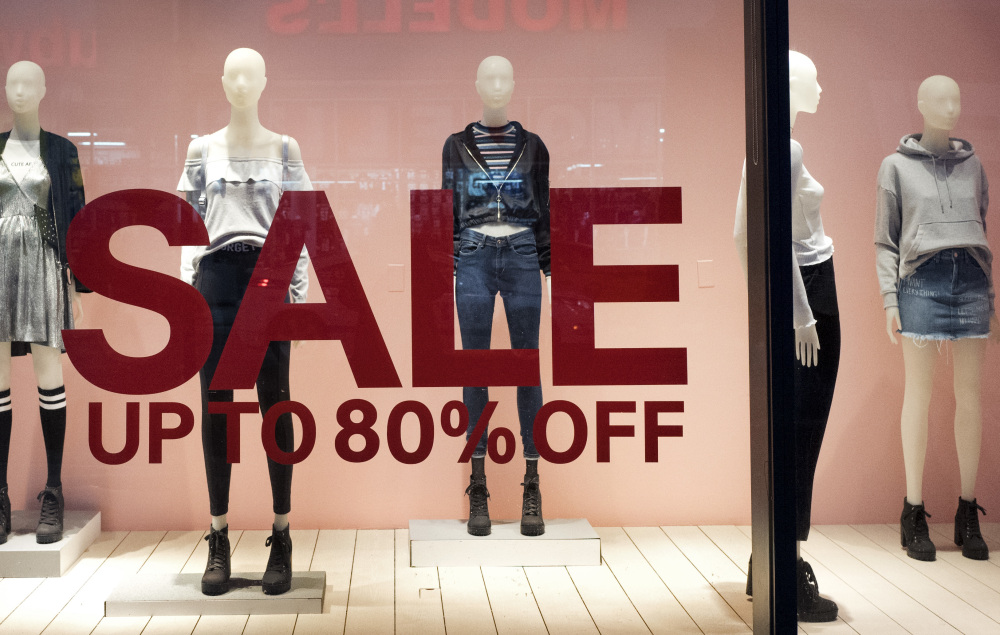 An H&M store window advertises a sale in New York. On Friday, the Commerce Department issued its February report on consumer spending, which accounts for roughly 70 percent of U.S. economic activity.