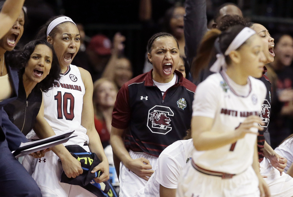 South Carolina guard Allisha Gray, 10, and teammates celebrate during the second half of the Gamecocks' 62-53 win over Stanford in the Final Four on Friday in Dallas.
