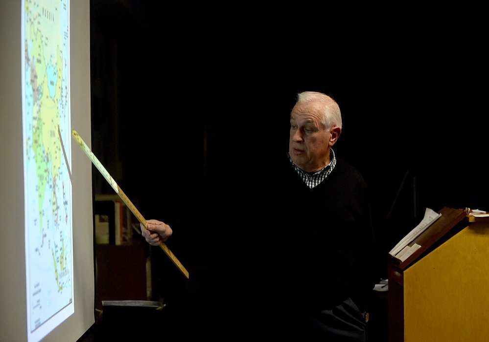 Douglas Cotchin, president of the Fairfield Historical Society, gives a presentation on the life of local hero Eugene Wing on Wednesday at the Lawrence Junior High School library in Fairfield.