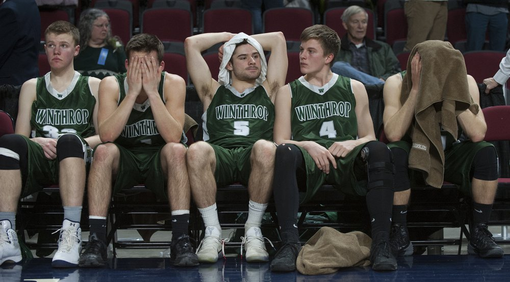 MARCH 4: Members of the Winthrop boys basketball team react after George Stevens Academy won the Class C state title at the Cross Insurance Center in Bangor.