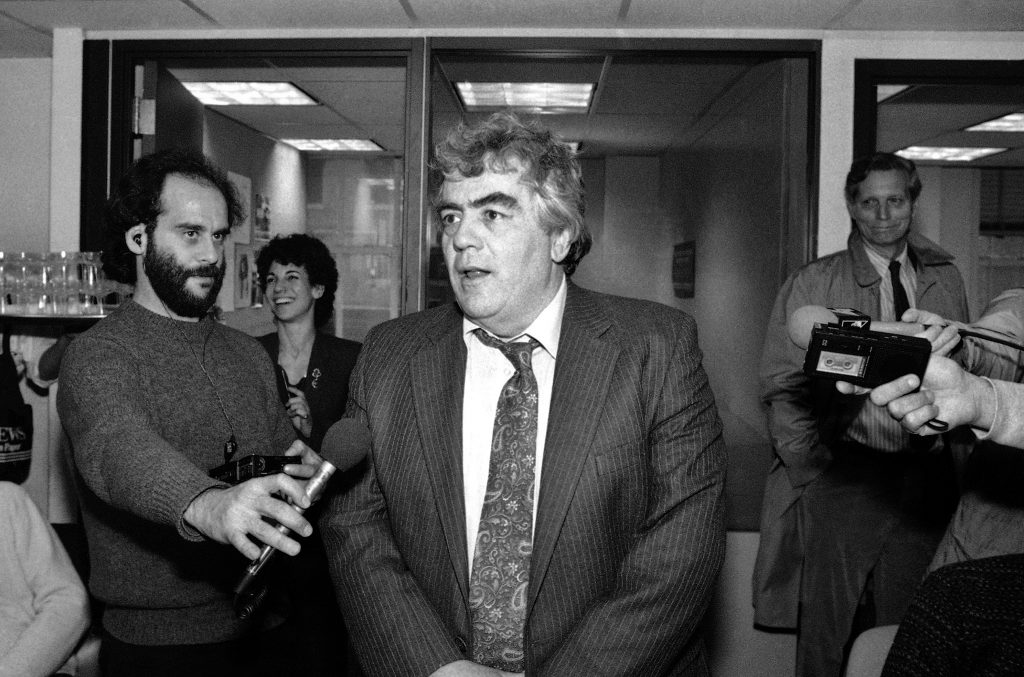 Jimmy Breslin speaks to reporters after winning the Pulitzer Prize for commentary in the newsroom of the New York Daily News on April 17, 1986.