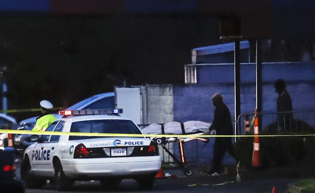 A body is removed as police work at the Cameo club after a fatal shooting on Sunday in Cincinnati.