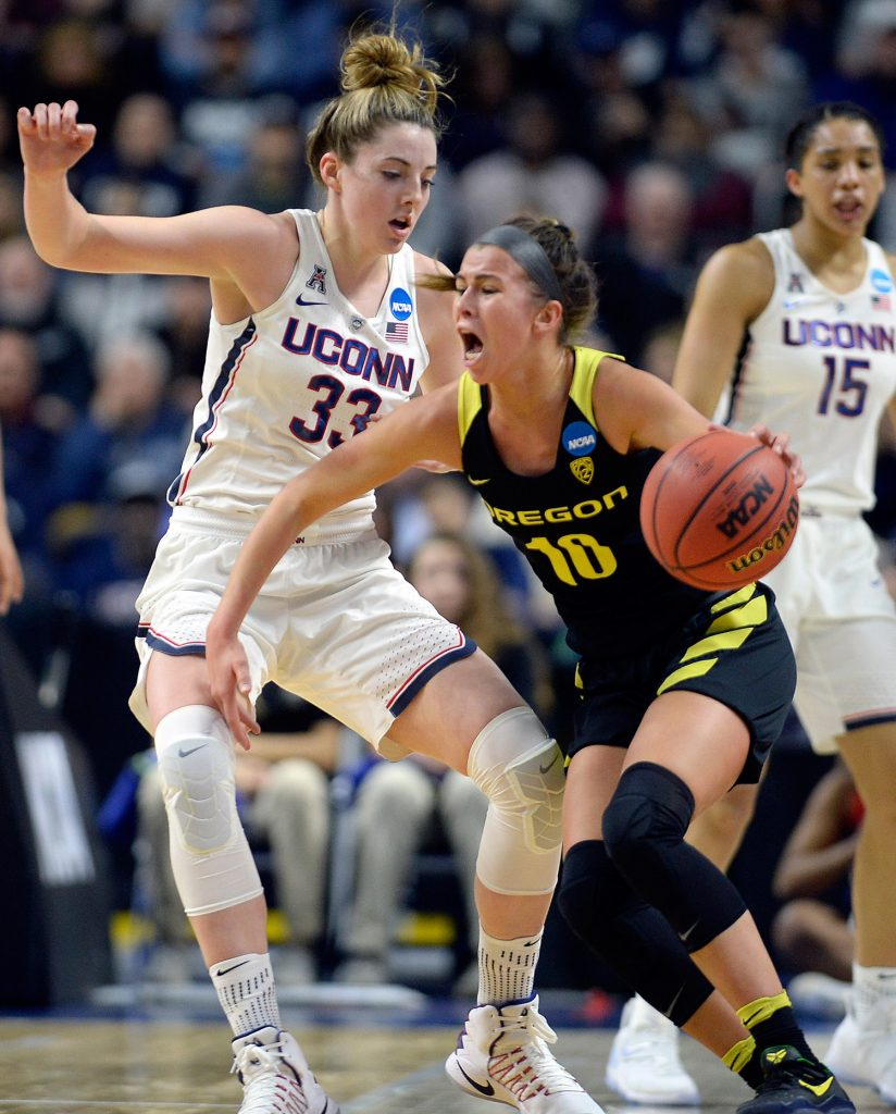 Connecticut's Katie Lou Samuelson defends against Oregon's Lexi Bando in the first half of Connecticut's 90-52 win.