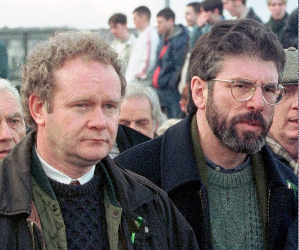 Martin McGuinness, left, then-Sinn Fein chief negotiator, and Gerry Adams, Sinn Fein's president, participate in the Bloody Sunday anniversary march in Londonderry, Northern Ireland, on Feb. 1, 1998.