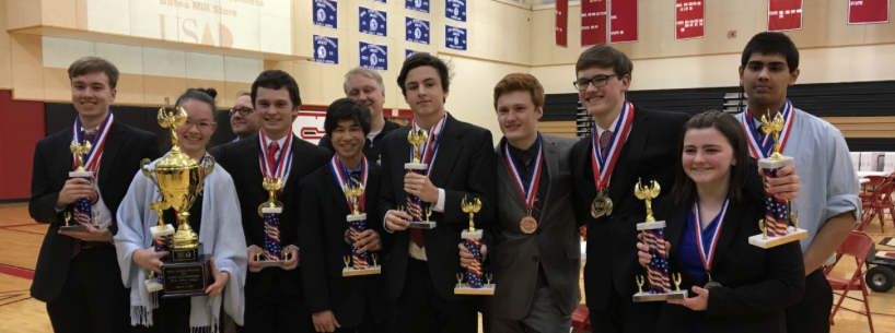 Members of Scarborough High School's Academic Decathlon team are: David Flewelling, Allison Lafferty, Jon York (assistant coach, rear), Evan Kane, Ian Youth, Shane Davis (head coach, rear), Sam Curtis, Eric Huber, Thomas Vachon, Katherine Kenney and Raja Muthyam.