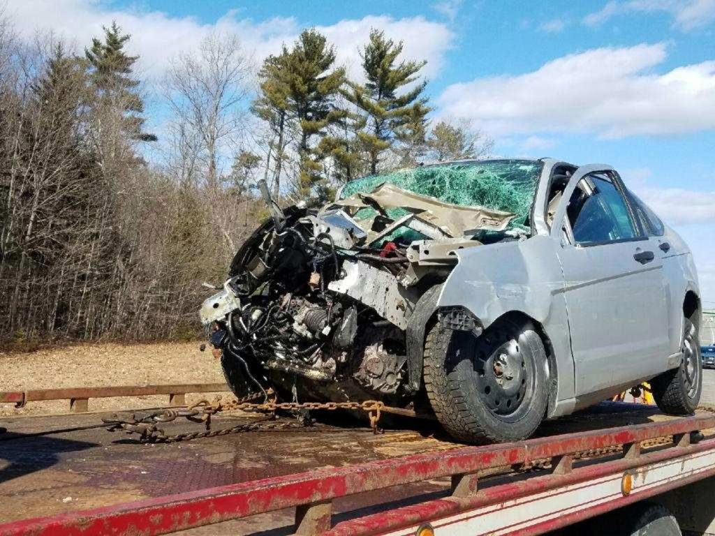 The driver of this car suffered serious injuries in a collision with a tractor-trailer around 12:30 p.m. at mile 40 southbound on the Maine Turnpike on Thursday.