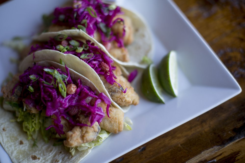 Rice-flour-battered local pollock fish tacos with cabbage and golden raisin slaw and kimchi remoulade.