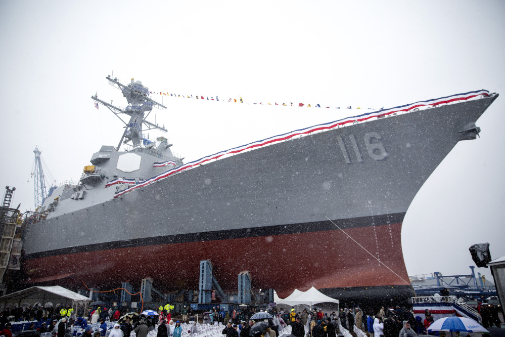 The future USS Thomas Hudner towers over the crowd at its christening ceremony at Bath Iron Works in April 2017.
