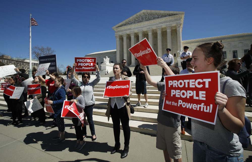 Protesters gather outside the Supreme Court last Wednesday to protest the nomination of Judge Neil Gorsuch to replace the late Justice Antonin Scalia on the high court.