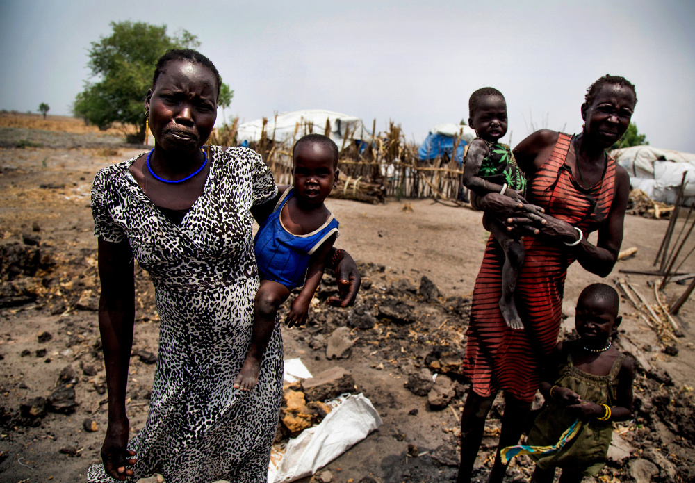 In 2013, a clash between the South Sudan president and vice president became a broader ethnic conflict that's left Nyakuma Tap, left, and her older sister Nyakuoth Kuol homeless and hungry after their house was destroyed.