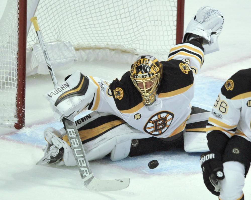 Anton Khudobin makes one of his 41 saves Sunday during the Bruins' 3-2 win over the Chicago Blackhawks. (Associated Press/Paul Beaty)