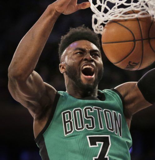 Jaylen Brown dunks for two of his 16 points Sunday during a 110-94 victory over the Knicks in New York. (Associated Press/Seth Wenig)