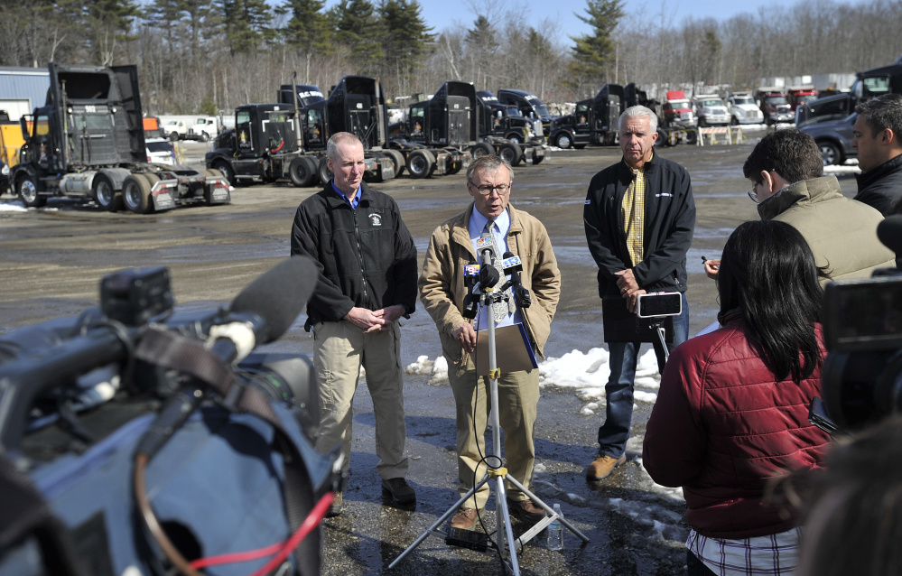From left, Sgt. Ken Grimes of the State Fire Marshal's Office, Maine Department of Public Safety spokesman Steve McCausland and Kelly Moore of R.C. Moore speak with the press Monday at the trucking company's facility in Poland. (Staff photo by Shawn Patrick Ouellette/Staff Photographer)