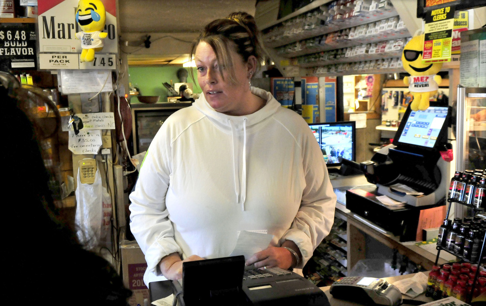 Patterson's Store cashier Angie Huff said the unusual circumstances in the death of neighbor Joyce Wood on Sunday and lack of information about the incident were on the minds of customers coming into the Burnham store all day Monday.