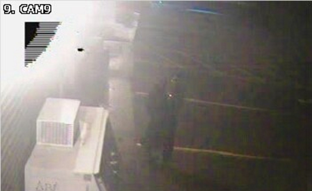 A surveillance photo from Annie's Market in Sidney shows the suspect police believe damaged the convenience store early Sunday. The suspect was described as a man who was wearing jeans, a skull face mask and a dark trench coat.