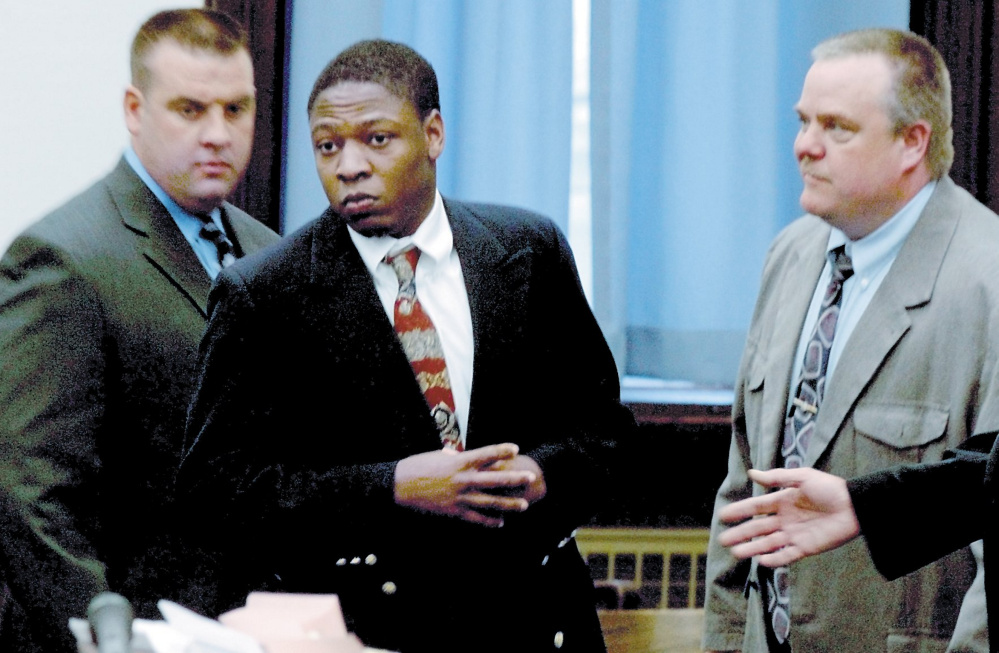 Daniel L. Fortune, center, is escorted by deputies into the Somerset County Superior Court in Skowhegan for the first day of his trial in 2011.