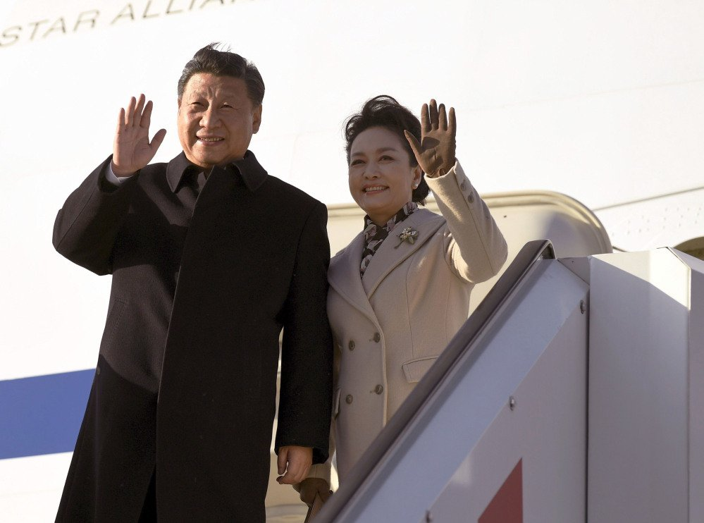 China's President Xi Jinping and his spouse, Peng Liyuan arrive Tuesday at Helsinki Airport, Finland, on their way to the United States. White House aides say two days of meetings with President Trump are intended to be an informal affair, but some foreign policy experts are worried that Trump will be at a disadvantage.