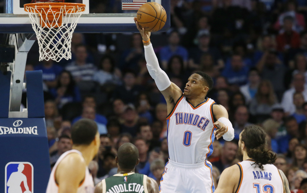 Oklahoma City guard Russell Westbrook goes up for a shot Tuesday during his record-tying triple-double performance against Milwaukee, a 110-79 win at home.