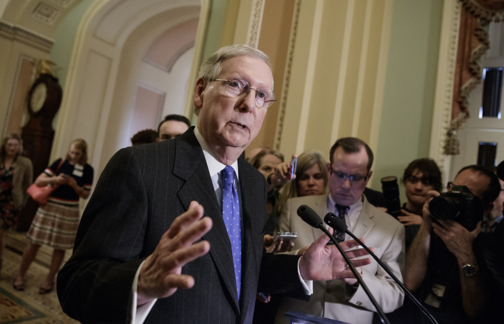 Senate Majority Leader Mitch McConnell of Kentucky speaks to reporters on Capitol Hill on Tuesday about moving Supreme Court nominee Neil Gorsuch toward a final vote in the Senate. He predicted Gorsuch would be approved on Friday, even if it means invoking a simple majority vote, called the